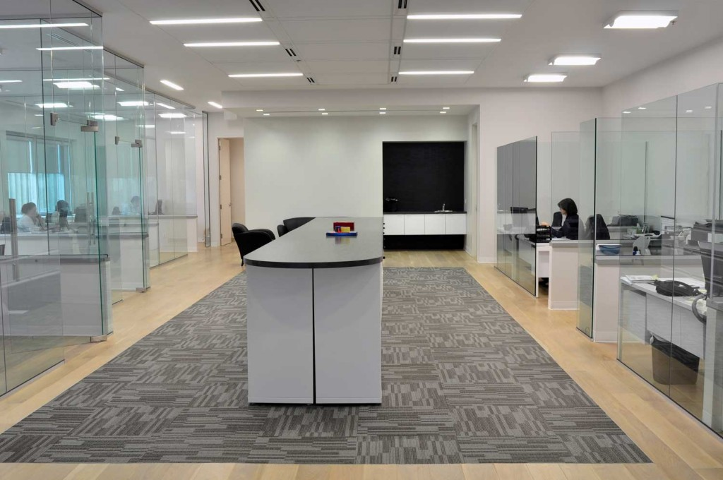 Office partitions constructed of glass.