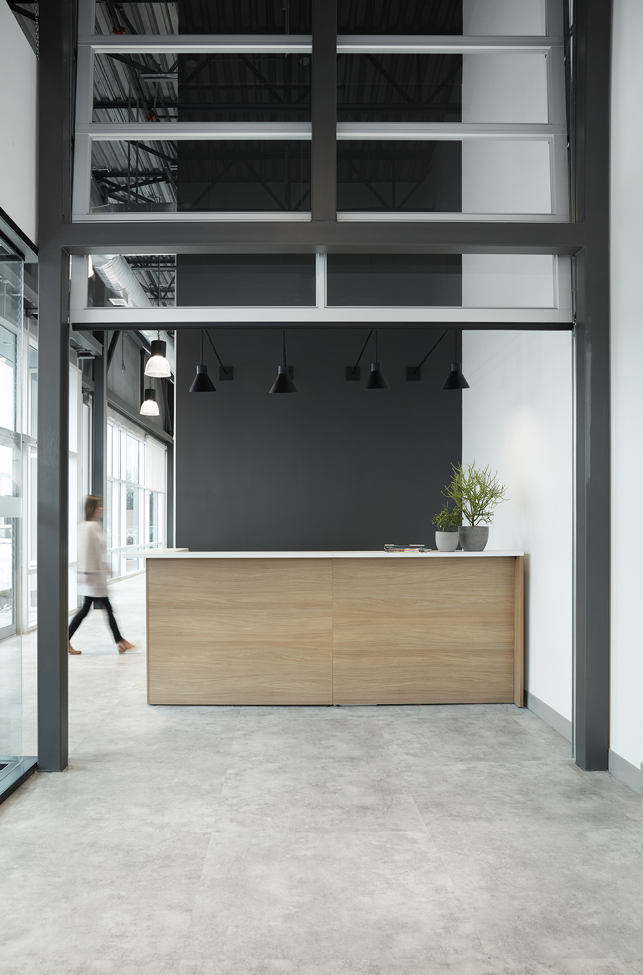 Reception Area with polished concrete floors and garage-style door.