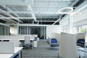 Modern office space with work stations and collaboration area